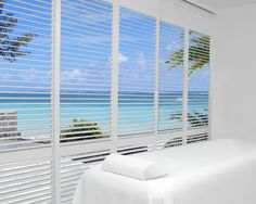Beautiful floor to ceiling windows with Hunter Douglas Palm Beach Shutters. 3'' Louver, Hidden tilt.
