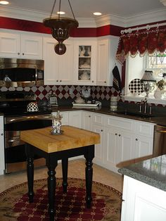 kitchen transformation with paint. love the red, diamond backsplash, and solid border under the crown moulding