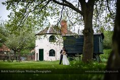 Bride and groom outside the Toll House at Avoncroft Museum of Historic Buildings (avoncroft.org.uk). Rob & Sarah Gillespie Photography