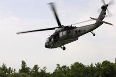 A U.S. Army UH-60 Black Hawk helicopter approaches the landing zone during a combat search and rescue training mission, June 24, 2014, at Cellina Meduna training ground near Maniago, Italy. Establishing a good relationship with other branches of the U.S. military helps mitigate risk and confusion in the event of a real-life situation requiring military intervention and assistance. (U.S. Air Force photo/Airman 1st Class Ryan Conroy)