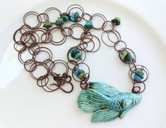 This necklace was made by Lori Anderson for the Bead Swap. Ceramic Fish, Turquoise Glass, African Beads, Small Things, How To Make Beads, Czech Glass Beads, Lampwork Beads, Soup, Jewelry Design