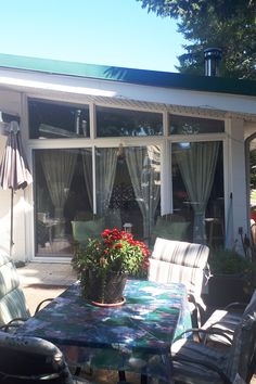 This aluminum frame sunroom is a great alternative to a stick built addition. It features a roof with thicker insulation than a three season sunroom roof. The windows are dual pane instead of single pane for better insulation. Best Insulation, Sunrooms, Living Spaces, Alternative, Deck, Construction, Windows, Patio, Seasons