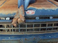 Perfect on the hood of a ford truck with jeans and cowboy boots on!