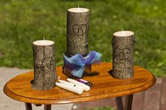 DIY unity candles. Lots more wedding logs here: http://offbeatbride.com/tag/logs