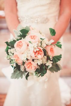 We're loving the green leafy accents in this pink bouquet -  perfect for a garden wedding! {Wild Green Yonder}