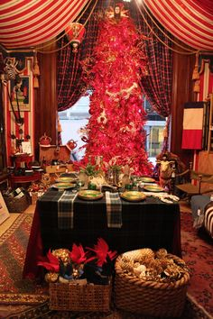 The Holiday Workshop by Bronson Van Wyck at the St. Regis in NY. He also decorated the hotel, but the shop is fabulously tented in red & white stripes and looks wonderful. (HabituallyChic)