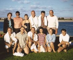 In September 1959, five of the seven Mercury astronauts visited the Convair plant in San Diego. They later went skiing in Mission Bay. John Glenn is in the middle of the back row, with a white towel around his neck. Wally Schirra, Jr. is to his left, also wearing a towel. Kneeling, from left to right, are fellow astronauts Scott Carpenter, Gus Grissom and Alan Shepard, Jr. Bill Johnson, who arranged the outing, is on the far right, in the white shirt. Steve Morgan