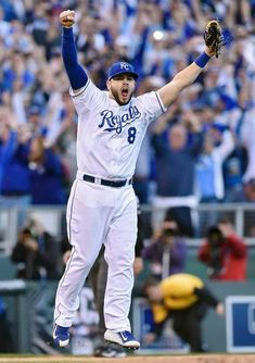 Kansas City Royals' Mike Moustakas (8) leaps into the air after throwing out the last batter at first for a 2-1 win over the Baltimore Orioles to clinch the series during Wednesday's ALCS baseball game on October 15, 2014 at Kauffman Stadium in Kansas City, Mo.