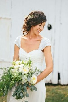 The Best Real Bride Hairstyles of 2015: Best tousled hairstyle - relaxed, sideswept updo for a rustic chic wedding {Stuido127 Photography}