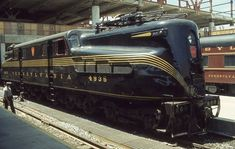 """(first posted The Pennsylvania Railroad electric locomotive can lay claim to a number of """"firsts"""", one of which was that it was the longest lasting locomotive in […] Electric Locomotive, Steam Locomotive, New York Central Railroad, Train Posters, Railroad Pictures, Train Truck, Pennsylvania Railroad, Old Trains, Train Engines"""
