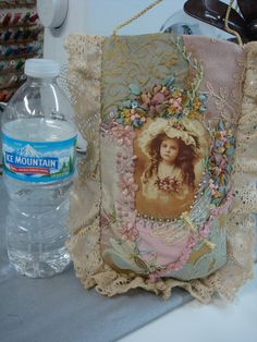 crazy quilted water bottle pouch by Pat Winter