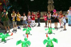 Dragon Party games - Dragon Obstacle Course, Dragon, Dragon, Night Fury (duck, duck, goose) & bow & arrow target practice.  Dragon training ends with tug o' war.  (I also liked the volcano putty in canvas favor bags)