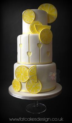 Lemon wedding cake! Yellow and grey wedding colours. Lemons and cutaway lemon hearts.