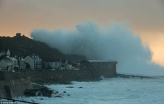 Massive waves crash over the cliffs at Sennen near Land's End in Cornwall today as experts...