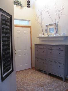 Ikea Shoe cabinets. love this entry way with no mudroom space!