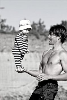 we have pictures of my dad doing this with each one of us kids when we were babies.  so cute.