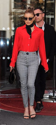 Brave face: Fergie, 42, continued to put on a brave face following her painful split from husband-of-eight-years Josh Duhamel, as she wore an incredibly sexy ensemble leaving her hotel during Paris Fashion Week on Tuesday