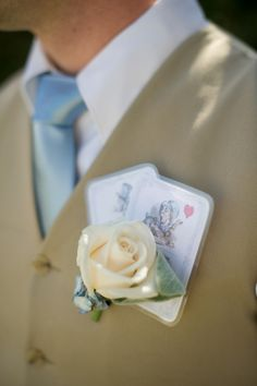 We like this creative Alice & Wonderland Theme wedding photo --Playing cards boutonnière  \\ Photo Credit: Flutter Glass Photography #whimsicalwedding #groom #weddingidea
