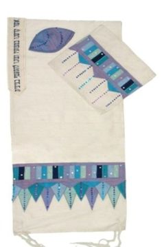 White Silk Tallit with Marrakesh Geometric Pattern in Shades of Blue and Purple by World of Judaica. $289.00. This white silk Tallit has a blue and purple geometric pattern on the sides and Hebrew words embroidered into the Atara on its top edge. This handsome white silk Tallit features a two-toned oriental geometric pattern that that includes triangles and boxes in different shades of blue and has a purple background. This Tallit also an Atara on its top edge th...