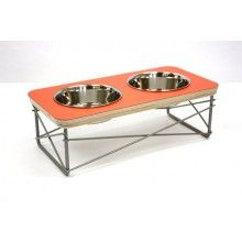 MODERN MEWS Double Bowl Pet Feeder Orange  --- The modern pet feeder is inspired by the iconic Eames side table. Handmade from baltic birch plywood, high pressure laminate, and welded steel, the feeder holds two 1 pint bowls and elevates them for more comfortable and healthier feeding.Features:- Wide, shallow bowls reduces whisker stress.- Bowls are heavy-weight stainless steel and dishwasher safe.- Durable, easy to clean laminate surface.- Hand formed, welded, and powder-coated steel base…
