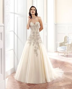 Couture Style CT137 Fabric: Tulle / Direct embroidery with heavy hand beading Available colors Ivory/ Gold / Ivory Silver Ivory / Ivory Silver