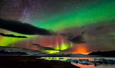 Northern lights Iceland-The northern lights, the milky way and an erupting volcano can all be seen in this amazing image