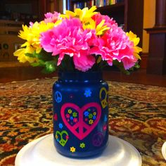 Easy craft!  I took an old Yankee candle jar.. Spray painted and got some scrapbook stickers... Put some flowers in and it's a easy, fun decoration!