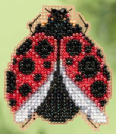 Ladybug Hug is the title of this cross stitch kit from Mill Hill Designs. The kit includes Beads, treasures, perforated paper, magnet, floss, needles, chart and instructions.