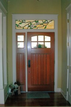 Custom stained glass window above a door.  Magnolia design.Created by Designer   Art Glass in Daytona Beach Fl.