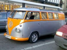 Silver and orange vw bus