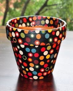 Items similar to Hot Dot Multi Dots on Black Flower Pot (Small) on Etsy Decoupage fabric onto a terra cotta flower pot - good idea for holidays to hold silverware - use fabric that matches the holiday Clay Pot Projects, Clay Pot Crafts, Painted Clay Pots, Painted Flower Pots, Painted Pebbles, Flower Pot Crafts, Flower Pot Art, Terracotta Flower Pots, Pot Jardin