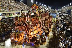 """This year, as always, Rio de Janeiro's Carnival last night ended as glittering as he should. Blaring music and scantily-clad dancers at the Sambadrome impressed the visitors."""