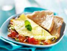 Cook up a hearty breakfast for your family with this vegetable infused omelet. Omelettes, Breakfast Muffins, Mexican Dishes, Vegan Dishes, Snack, Entrees, Tapas, Sandwiches, Curry