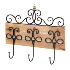 Organization can be beautiful, especially when you hang your hat (and your coat and bag) on this pretty wall hook. Three decorative metal hooks mounted to a rustic wooden base create a organization station for your entry way, hall and beyond. Topped with scrolling metalwork and finished with a gleaming finial, this three-hook accessory is a fashionable and functional addition to your home.