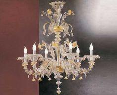 #Lampadario #rezzonico #vetro  Lampadario rezzonico vetro oro e trasparente. H. 105 cm – ø. 95 cm Dimensioni e colori disponibili su richiesta