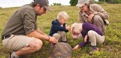 Ranger Mike teaching the kids doing the mini rangers course about the Leopard Tortoise at River Bend Lodge, Addo, South Africa.