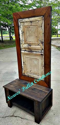 "RECYCLED PALLET WOOD: For sale Hall Tree with a white, ""chippy"" paint, vintage Tin Ceiling Tile on the back with 100-year old cedar shiplap for the frame. This Hall Tree will come with two Fleur de Lis single hooks on either side of the Hall Tree. The Hall Tree is 74"" tall x 36"" wide x 18"" deep. The shelf is 7"" from the ground with the bench being 18"" high. We are asking $225. Item#1,361"