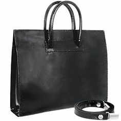 This handbag is made in shiny and smooth black leather. Detachable shoulder strap and signature dust bag included. Made in Italy. Handles: Double Leather handles Handle drop: Hardware: Silver metal Lining: Natural Leather Pockets: 2 compartments   1 zippered Closure: Snap