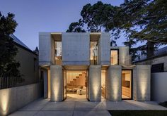 A rear extension to a Glebe house required a high degree of in-built privacy to screen a double-level addition from a big block of flats. So Nobbs Radford Architects created a cloister-like arrangement of deeply recessed vertical windows in an uncompromisingly concrete facade.