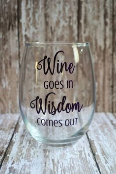 Wine goes in Wisdom comes out Stemless Wine glass This fun wine glass is perfect for any wine lover or for your next girls night! This design is high quality permanent VINYL **Wine glass MUST BE hand-washed gently in order to preserve the design** Wine glass is 21 oz. Design shown in Purple, other colors are available. Color chart in pictures Because each design is handmade and hand-placed, each order may vary slightly