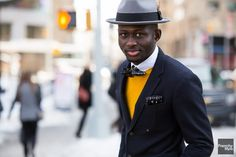 Love the pop of yellow against his black jacket and gray hat (note: flecks of yellow in tie and pocket square that bring outfit together)