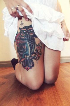 Owl thigh tattoo