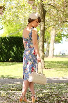 Whispering Ivy Ruby floral wiggle dress and ivory pillbox hat and frame bag--and the shoes, I'll take it all.