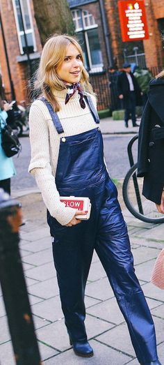 Pernille Teisbaek in a cream chunky knit under black leather overalls
