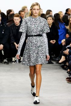 """Proenza Schouler, New York Fashion Week Fall 2014. Outfit in grey abstract """"marble"""" patterned melange, long short-sleevd t-shirt-dress over similar patterned long-sleeved, black skinny belt, black and white flats."""