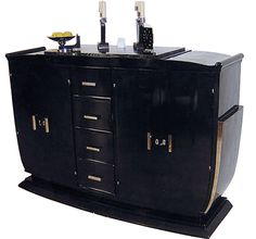 """Unusual """"U""""-shaped designed black lacquered French Art Deco buffet on splayed socle. 1920's/30's. Four drawers in vertical order flanked by 2 door-cabinets. Each with its original Pasquille lock in brass and 2 shelves. Original hinges, keyplates, keys and complete set of 7 original chromium-plated handles. Original marble-top."""