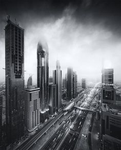 Urban black and white photography by Alisdair Miller of the Dubai's skyline.    On Tumblr.