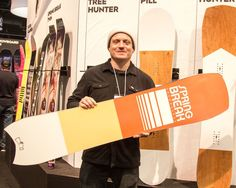 Head to www.TWSNOW.com to get a first look at next year's 2018 snowboarding gear. Here's @coreysmithsimulacrum showing off one of the more talked about boards at the trade show the @springbreaksnowboarding Mini Tree Hunter. Photo: @taylormboyd #twsnow