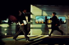 SYDNEY, Australia—Rush hour in the morning as a woman runs to catch the train at Circular Quay train station. The Sydney Harbour bridge is reflected in one of the passenger windows, © Trent Parke / Magnum Photos Documentary Photography, Book Photography, Street Photography, Colour Photography, Magnum Photos, World Press Photo, Photo Awards, Rush Hour, Famous Photographers