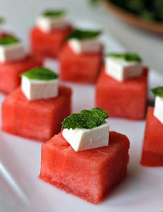 Watermelon Feta bites are a refreshing, low-fat appetizer that takes seconds to put together! www.mantitlement.com